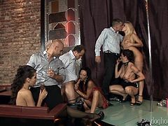 These really sexy ladies are putting on a good show for all these lucky guys. They dance around the stripper pole and then, use a double sided dildo, to get each other off, while the men watch the hot sex. Now they want to suck cock.