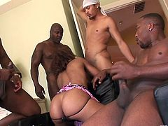 Curly-haired ebony bitch enjoys passioanate gangbang sex