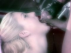 Lustful blonde wearing fishnets blows and gets fucked in a garage