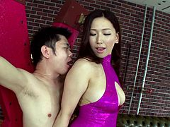 Dominant Japanese mistress Ai has tied up her slave and she is torturing, and teasing him. She kisses him seductively, but she also kicks him in the balls. She rubs her body against him and even, makes him sniff her stinky armpit.