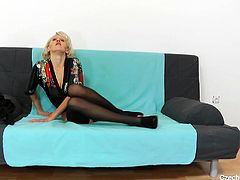 This sexy blonde mature lady still knows, how to get men really horny. She spreads her pussy lips wide, so all the horny guys out there can see into her pink pussy. She lays back on the couch and gets herself off with her fingers.