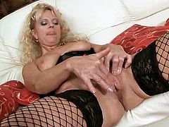 Horny mom in stockings just loves her pussy so much that she plays with it using a dildo.