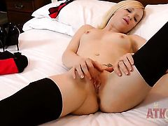 Blonde exotic stripping down to her birthday suit and plays with herself
