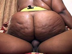 Big fat black momma takes a big hard cock for a ride.