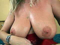 Slutty mature blonde Sandy has big hooters and a big appetite for hardcore sex and gets her craving for big cock filled in this free tube video.