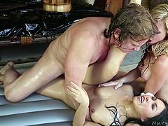 These two lovely girls love, to make this man feel good with a nuru massage. However, both the man and the women want more. The chicks are on their knees sucking his cock. He takes turn pounding each of them hard on the air mattress.