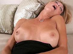 Busty MILF prepares her pussy for fat dick with an even fatter dong in the kitchen.