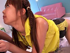 The smiling Asian teen beauty in the video wanna improve her flexibility and does a lot of exercises, to keep fit. She only wears panties and a t-shirt. Her pigtails look very funny, but this Japanese girl can get really wild, when a cock is around. Just click and watch the slutty little bitch sucking cock!
