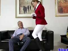 Amateur equestrian is getting kinky at the couch as she started to reveal her bootylicious ass. She then called her old man and he started caressing it while she jerk his old cock.