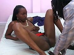 Hot black babe shaves her cunt to get ready for some pussy-licking and cunt-fucking with a huge black dong.