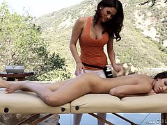 This lovely girl is here for a treat today. Not only does she have her supple white skin rubbed by two amazingly sexy Latina goddesses, but she also has her dripping wet pussy eaten out, by one of the dark skinned beauties.