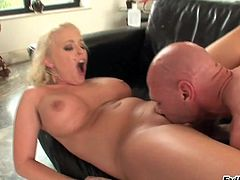 A tattooed blonde with big tits fucks and takes jizz on her tits