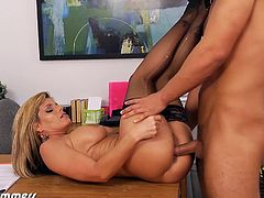 Huge titted office babe Kristal Summers got her seduced by her employee and got fucked after office hours. They positioned themselves on the desk, leaned on and fucked her twat in doggy.