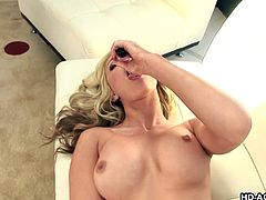 Solo model blonde with big tits moaning while fingering her juicy pussy