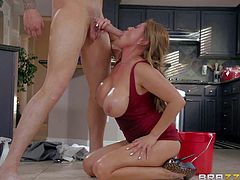 Kianna Dior is a hot bodied asian mom from China.She pulls out her massive tits to turn guy on to the point of no return. She sucks his fat dick and he plays with her juggs in the kitchen.
