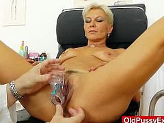 Blonde granny's first gyno on the year 2015 and here she got her trimmed pussy spread wide open with the doctor's speculum opening it wide and cleaning it in front of the camera.