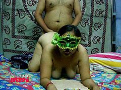 This chubby Indian whore is super horny! She's not afraid to show off her big tits and ass, but she keeps her face hidden. She gives him head and then, bends over in front of him, to take his hard cock from behind.