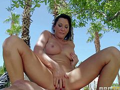 Hot bodied busty MILF brunette Lezley Zen with big boobs and shapely ass gets her pink pussy pumped full of cock under the palm tree. She screams like crazy during outdoor fuck session.