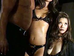 Marvelous Asian cowgirl with small tits in leather bikini pose seductively with her masculine man in a reality threesome sex story
