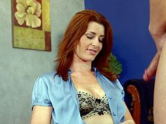 Pleasing redhead dame with long hair unpins her bra displaying her natural tits before giving her horny guy blowjob in a reality shoot
