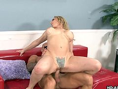 Blonde milf gets to suck hard on the dude's fat rod so she arouses him and then she gets to be fucked from the back doggy style real fucking hard.