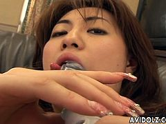 Sweet Asian babe is wanking hard on her wet cunt that has a thick bush above it. She uses a dildo to cum harder. She really wants that orgasm.