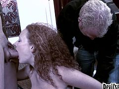 curly hair girl gets two cocks at one time