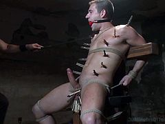 This stud is curious of anything about BDSM so he goes into the 30 Minutes of Torment to experience it for the first time and he got clipped and spanked and drowned.