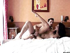 Lou Charmelle has fire in her eyes as she gets her mouth banged by Manuel Ferrara after backdoor sex