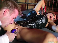 A foxy redhead babe is freed from the cell she was put in. Her black latex outfit is a huge turn on. She looks so damn hot! The exiled princess, wearing a sublime makeup and high heeled boots, gets very horny after her cunt is aroused with the help of a dildo. Click to see Madison sucking a big cock with frenzy!