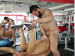 These muscular men are working their cores, and it gets them really horny. They want to fuck each other right there in the gym. One of the guys bends over and takes his lover's huge cock right into his asshole. It feels so good to have a massive dick in his ass!