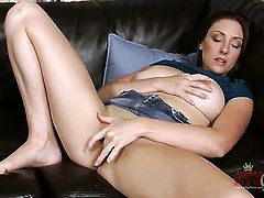 Brunette Melanie Hicks has fire in her eyes as she fucks herself with her fingers