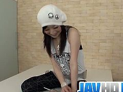 Pretty Japanese Asuka Mimi spreads her legs here as her partner want to to use her magic wand into her hairy pussy making it super wet before drilling it with a real cock.