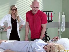 A sexy blonde doctor offers an unforgettable blowjob to a guy, who just come to visit his sick girlfriend. However, the lusty man cannot oppose the seductive lady in uniform and conforms to the situation without remorse. Tattooed Jessa gets down on knees, totally engaged in a deep throat sensational blowjob.