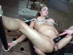 Abbey has fantastic big tits, which her dominant partner knows how to put in value, using a creative rope bondage. Click to watch the blonde-haired slut while being screwed with legs widely spread. The image of her shaved peachy pussy getting deeply fingered is amazing!