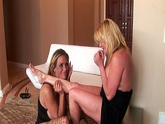 Debi Diamond and Ginger Lynn act a little rough with each other. They slap each others huge boobs and pussies and they rub each others cunts with their feet.