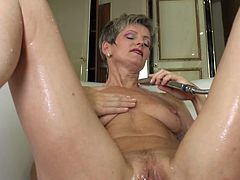 Carla loves to fuck and when she can't get young men to shove dicks in her pussy, she goes solo. Watch this old cunt do what women her age would never think of doing. She lies in the tub with her sexy, shaven pussy and fingers her cunt. She even sprinkles water on her natural boobs, that are still taut and sexy at this age. This cunt make the boys really hard.