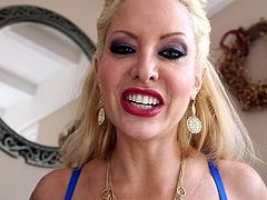 The blonde-haired milf in the video seems to be a versed slut. She has seducing eyes and crazy tits. Her colorful tattoos are also a huge turn on. You can read excitement in her look, as she comes near the guy and begins sucking his dick, and balls. Watch the inciting scenes and enjoy!