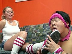 Dominating plump blonde makes horny guy lick her feet