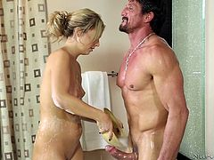 An attractive blonde babe offers more than a simple relaxing massage. The atmosphere in the bath tub gets hotter, when the naked girl begins sucking her partner's cock with lust. After they finish bathing, sexy Madelyn oils the guy's body from head to toe. The tattooed masseuse seems to know what she's doing!
