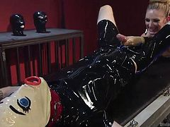 The gimp slave in the clown mask has been let out of the cage, to be treated badly by the mean mistress. She shoves her big black strap on down his throat, until he can't take it any more. Watch him choke on that plastic dick.