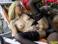 Sexy blonde Charley Spark gets ass fucked in the backyard by a black dude with a massive cock. She takes it like a champ from every position he wants to fuck her in.