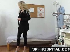 Courtesy of Spy Hospital you can see how a nasty brunette slut gets her shaved pink cunt perversely examined by a naughty doctor.She is really hot and she don't know that we can see her pussy too!