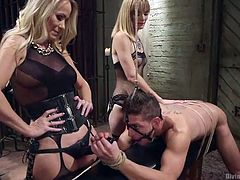 The male slave gets his ass fucked hard with the strap on, from one of the blonde mistresses. He gives a handjob to the other mistresses strap on. His ass is getting fucked hard. How much more of this humiliation can he take?
