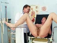 Mature pussy is wet during her medical exam