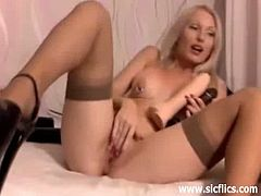 This blonde slut gets a whole man fist inside her twat. Then, she stuffs herself with two big dildos, followed by a really huge black dildo. Both her nipples and pussy lips are pierced.