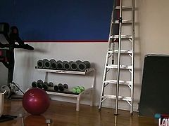 Sporty brunette girl brags of her ass while doing exercises in the gym