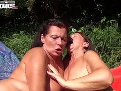 Perverted grannies lick each others nipples and give blowjob to one lucky dude in the garden