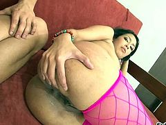 Asstastic Columbian babe in pink fishnets gets doggy fucked by white dude hard