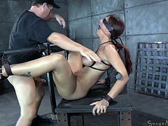 Busty blindfolded MILF Syren De Mer gets restrained in strict device and fucked hard